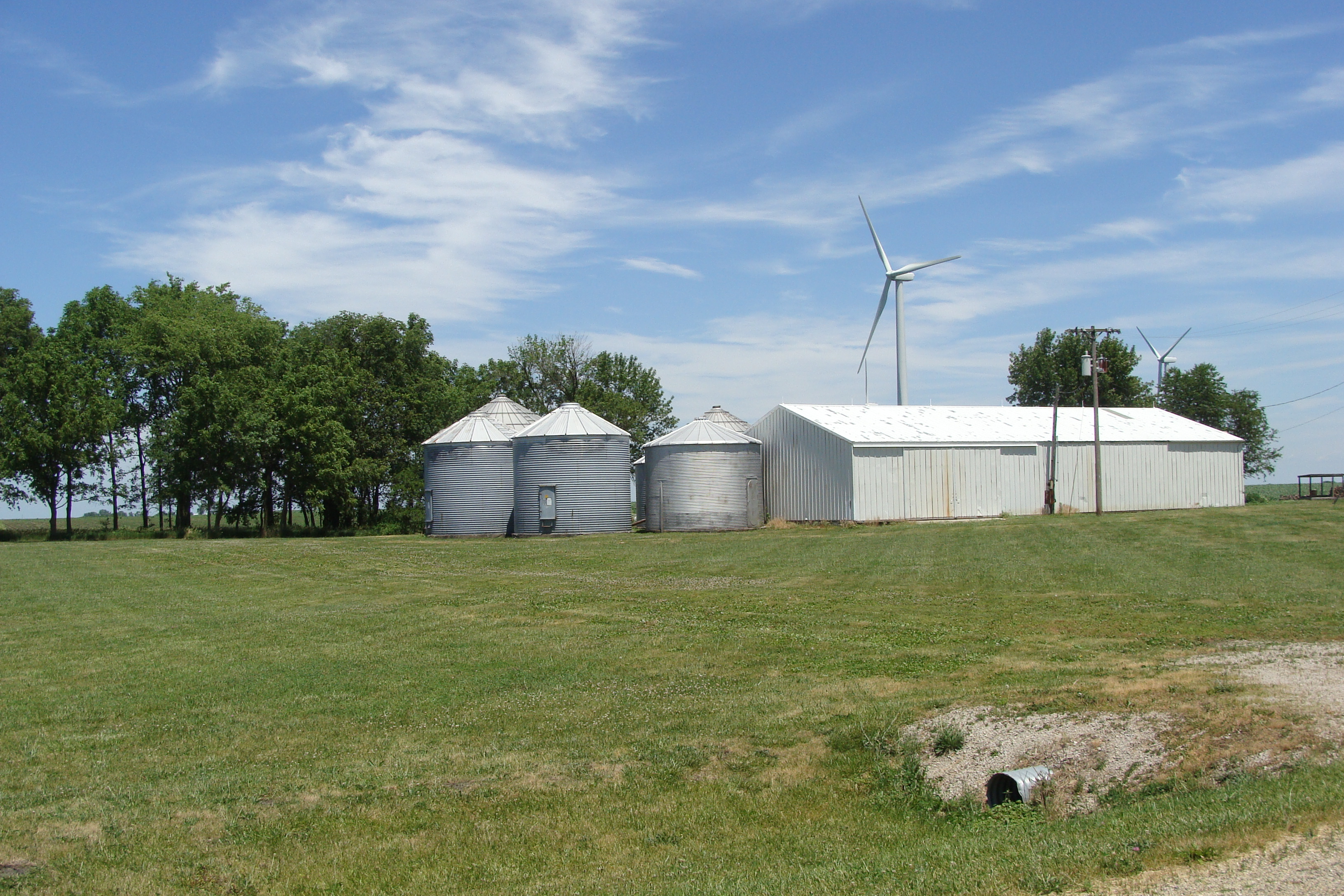 Picture of machine shed, bins, and win turbine