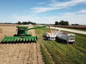 picture of combine dumping corn into weigh wagon